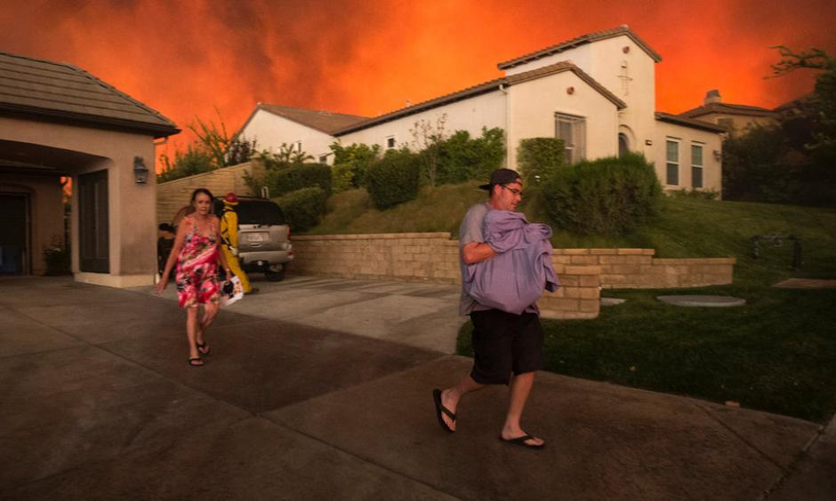 People left their homes on Saturday as a wildfire approached Santa Clarita, Calif. Photo: David Mcnew / Agence France-Presse / Getty Images