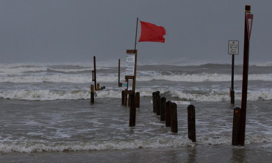 Rising waters at Bob Hall Pier in Corpus Christi, Texas, as Hurricane Harvey approached on Friday. Credit Courtney Sacco/Corpus Christi Caller-Times, via Associated Press