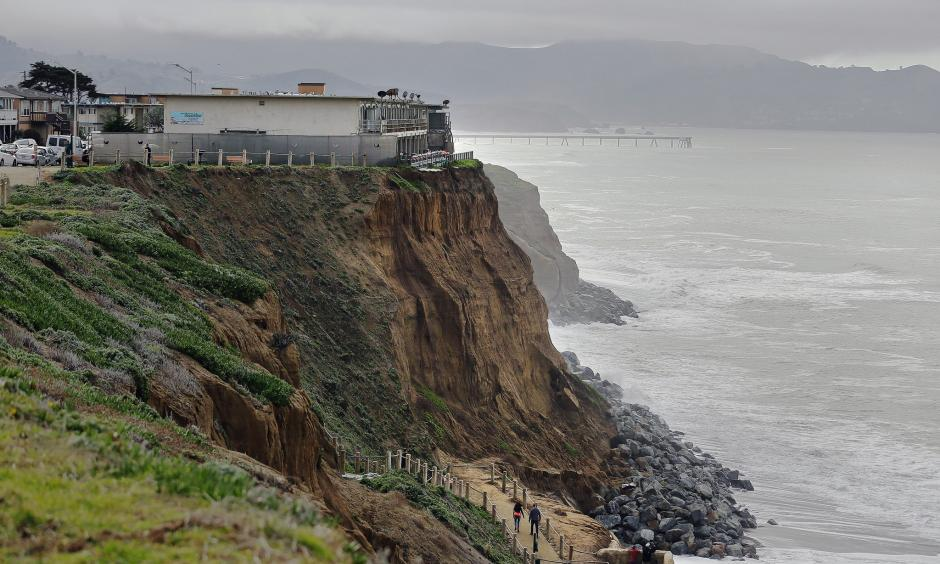 Apartments sit on the edge of an eroding coastal bluff in Pacifica, Calif. Photo: Eric Risberg, AP