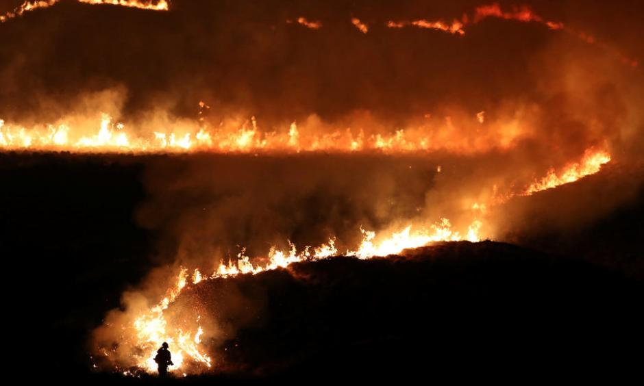 Firefighters tackled a blaze on Marsden Moor in northwest England that began on Tuesday night. Photo: Jon Super, Reuters