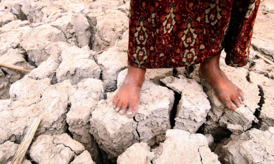 An Iraqi girl stands on former marshland, drained in the 1990s because of politically motivated water policies. Photo: Essam Al-Sudani, AFP, Getty Images