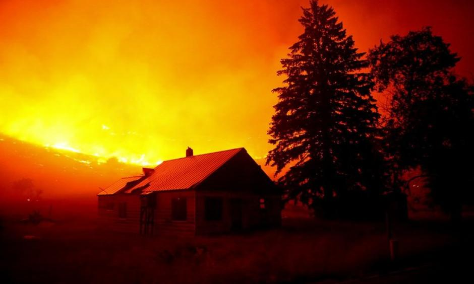 Flames blanket the hillsides on Twisp River Road just outside of the town of Twisp, Wash. last week. More than 900,000 acres have already burned this year in Washington wildfires. Photo: Erika Schultz, The Seattle Times