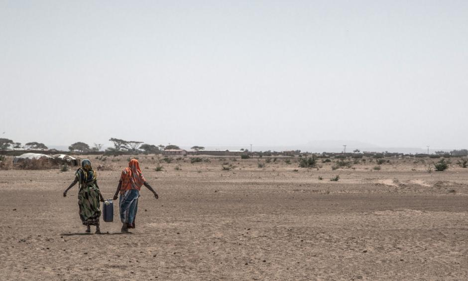 Women carry water back to their homes in drought-hit Aydora, Ethiopia. The country is facing its third straight year of drought. Photo: Aida Muluneh for The Washington Post