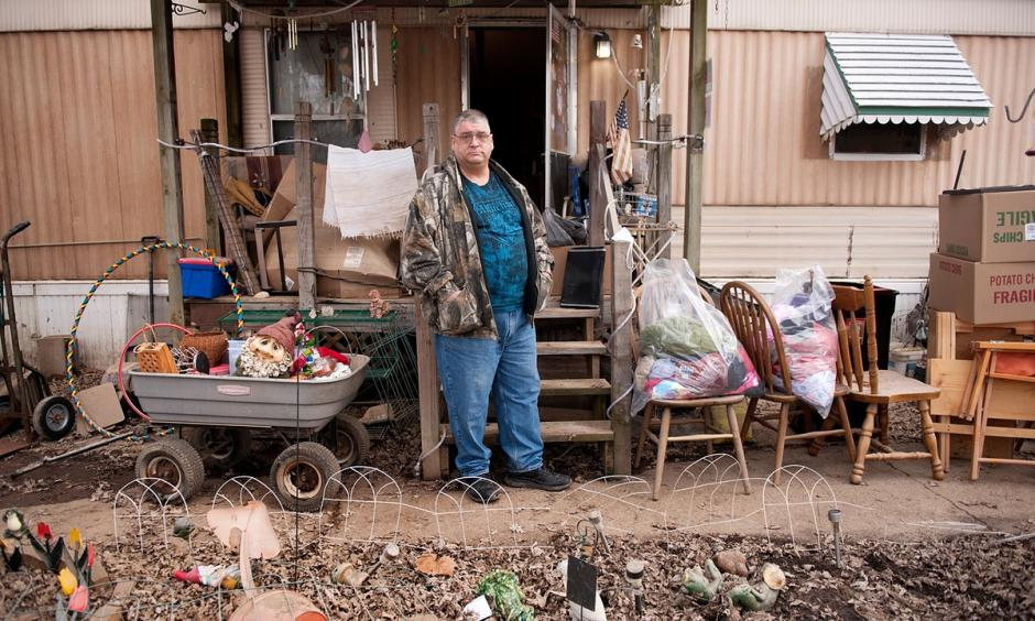 Damon Thorne poses for a photograph with items salvaged from his home, flooded last week by water from the nearby Meramec River, in a trailer park near Arnold, Missouri. Photo: Sid Hastings, The Guardian