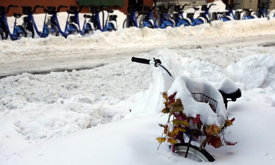 A snow covered bicycle is stuck in a snow bank on the the Lower East side, a day after winter storm Jonas hit New York  Photo: EPA