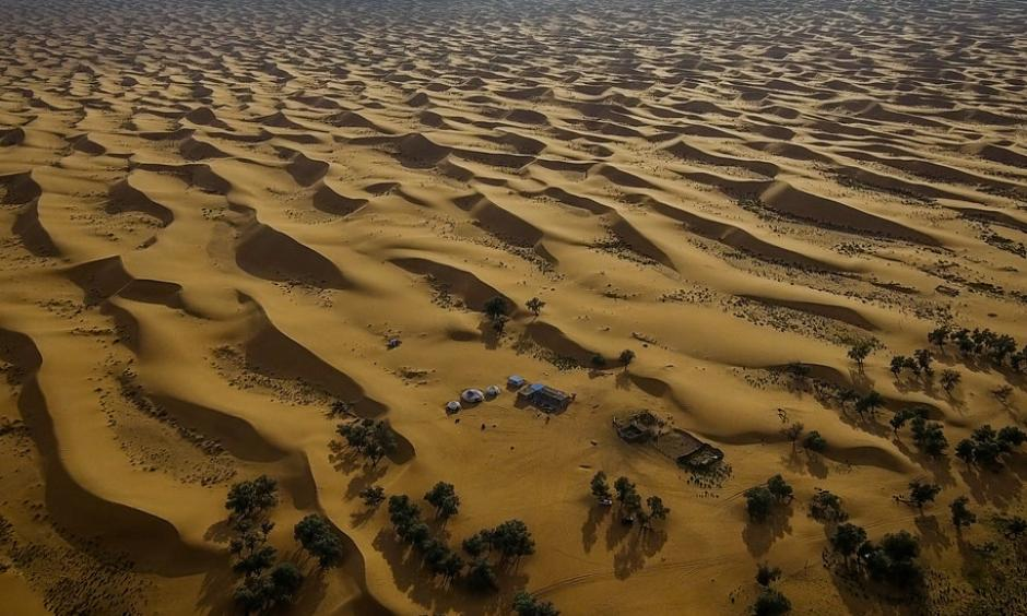 The Tengger desert in Inner Mongolia. Government efforts to halt the expansion of deserts have included tree-planting projects and restrictions on grazing. Photo: Josh Haner, The New York Times