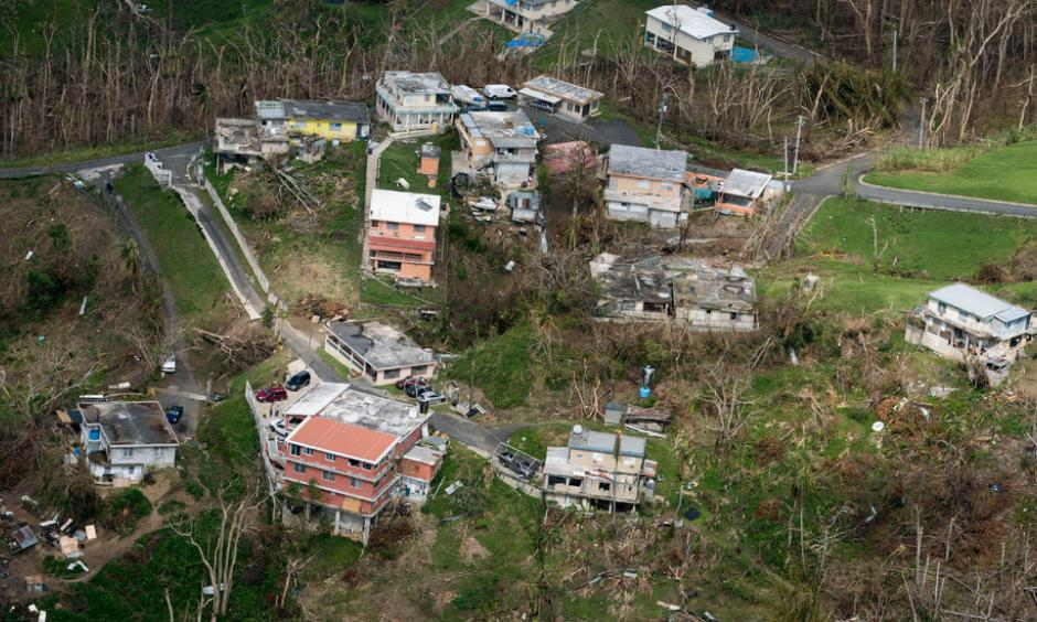Houses that suffered damage from Hurricane Maria in San Juan, P.R., last October. Photo: Doug Mills, The New York Times