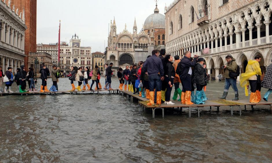 Visitors to Saint Mark's Square in Venice used raised walkways on Monday. Photo: Manuel Silvestri, Reuters