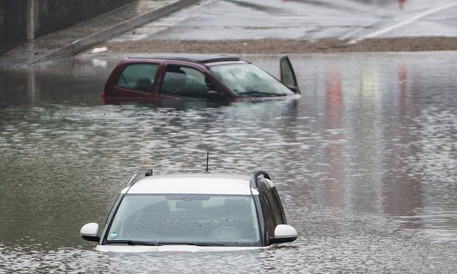 Cars are submerged in an underpass in Oberhausen after torrential rains caused flash floods across southern Germany. Photo: AP