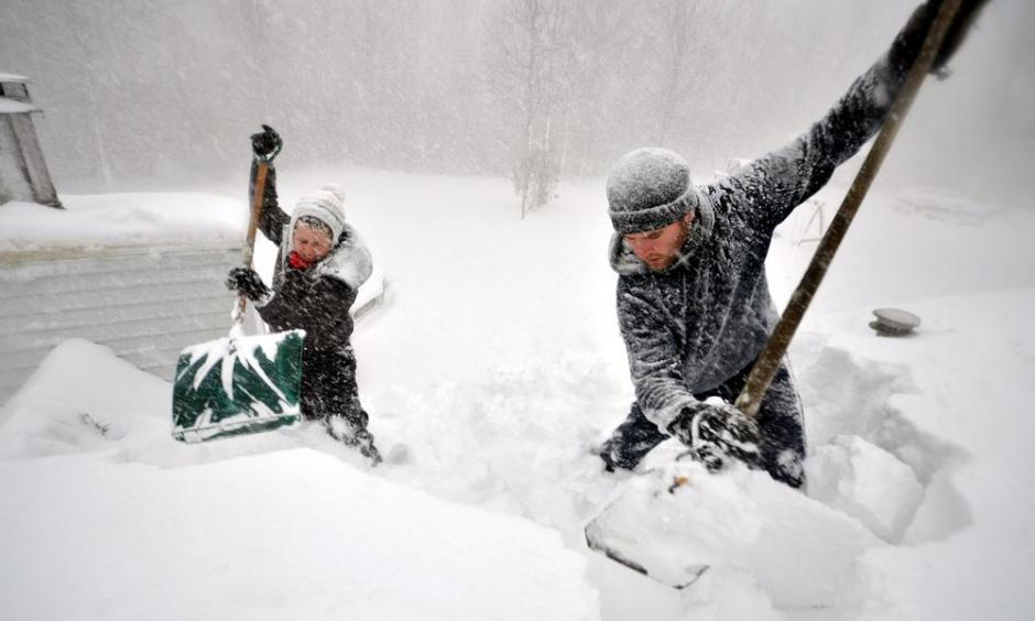 Hardy Buffalonians dig out from the massive storm. Photo: John Normile, Getty Images