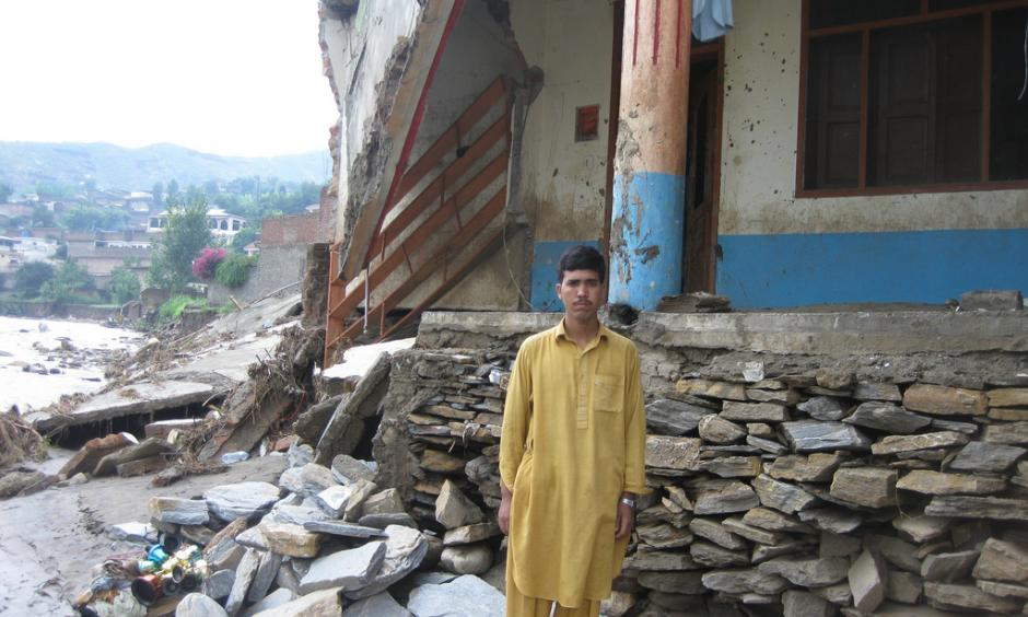 Fazal Mowla stands in front of his collapsed house in Faizabad village in Swat. Photo: Oxfam International