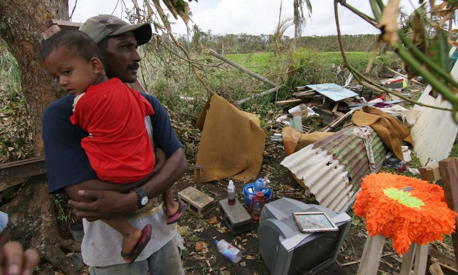 A Fijian resident looks at the damage caused by Cyclone Winston. Photo: AFP/Getty Images