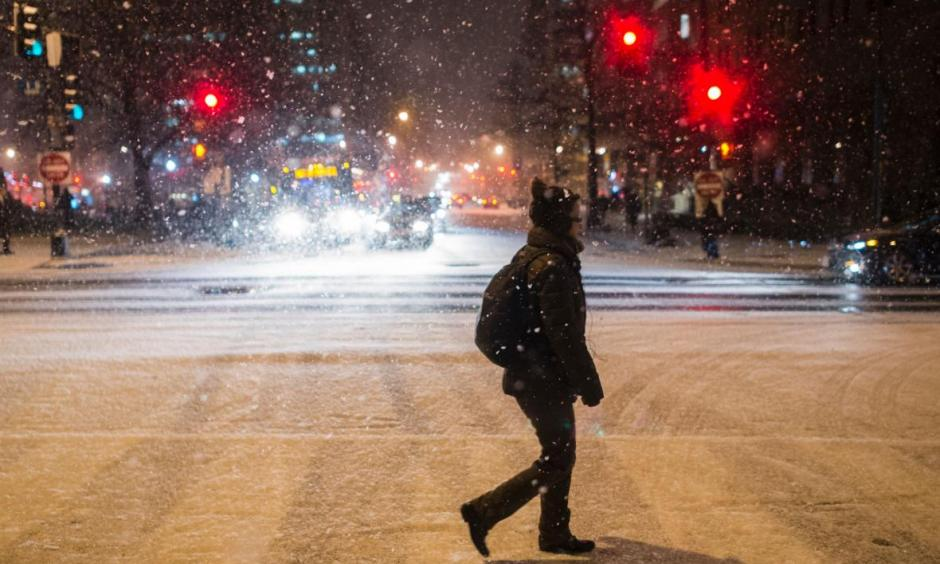 A woman crosses the street as it snows in Washington, D.C., on Jan. 20, 2016. Get ready, D.C., it's about to get much, much worse. Photo: Andrew Cabellero-Reynolds, AFP/Getty Images