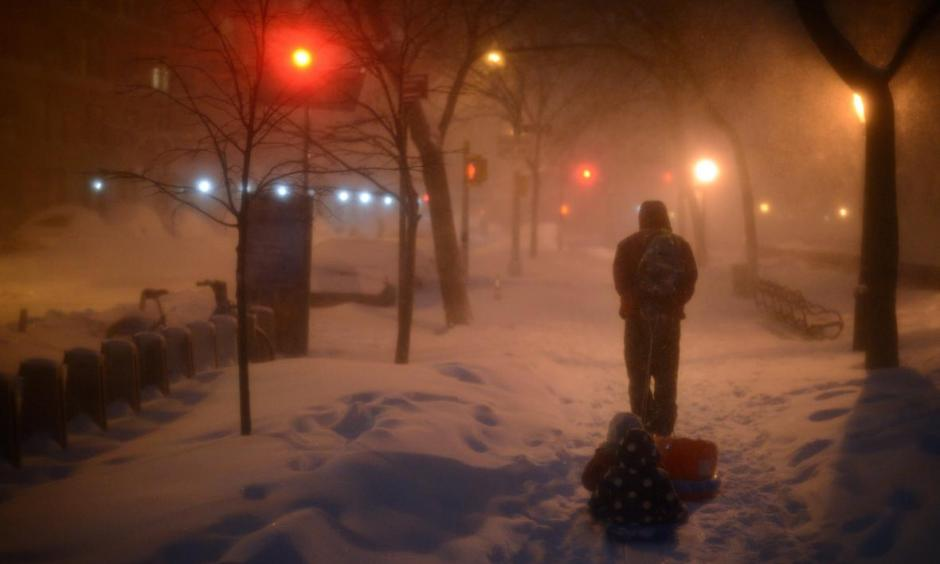 Children are pulled home after playing at Riverside Park, which was covered in snow after a day of constant snowfall in New York City on Jan. 23, 2016—the city's snowiest day ever. Photo: Astrid Riecken, Getty Images
