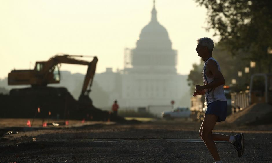 The Capitol can be seen as a jogger runs along the National Mall on July 21 in Washington, where area temperatures are forecasted to reach the upper 90s for the next few days. Photo: Mark Wilson / Getty Images