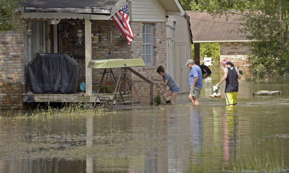 Homeowners return to their flooded home on Prince Road in St. Amant during Ascension Parish flooding and cleanup on Thursday, August 18, 2016. Photo: Bill Feig