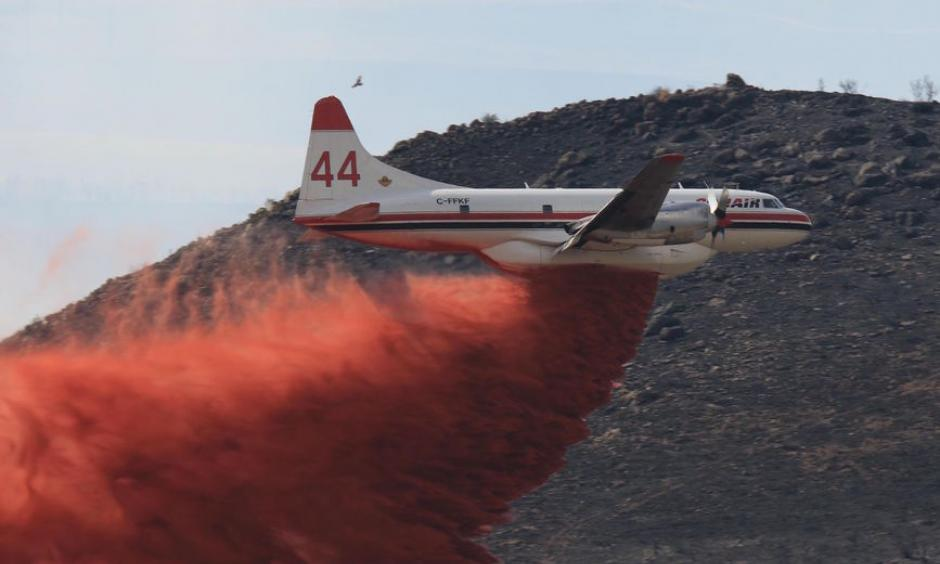 An air tanker drops retardant on the wildfire burning near Idaho Falls. Fire officials announced Sunday that the blaze was nearly 70 percent contained. Photo: Eastern Idaho Interagency Fire Center