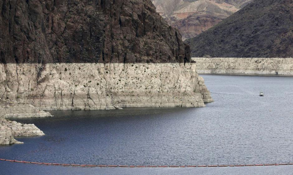 "In this April 16, 2013 file photo, a ""bathtub ring"" marks the high water mark as a recreational boat approaches Hoover Dam along Black Canyon on Lake Mead. Photo: Julie Jacobson, AP, File"