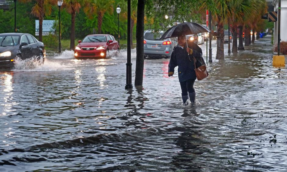 Traffic moves through a flooded King Street in Charleston on Monday, April 24, 2017. Photo: Matthew Fortner