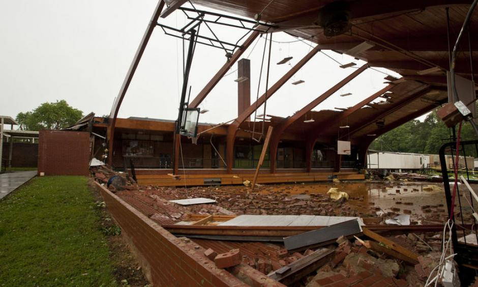 The roof was blown off the gym at Courtney Elementary School and the end walls were blown in by a tornado that passed through the area Wednesday. Photo: Walt Unks
