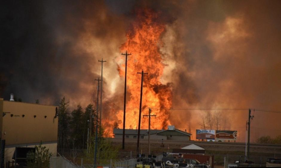 Flames rise in Industrial area south Fort McMurray, Alberta Canada May 3, 2016. Photo: CBS News, Reuters