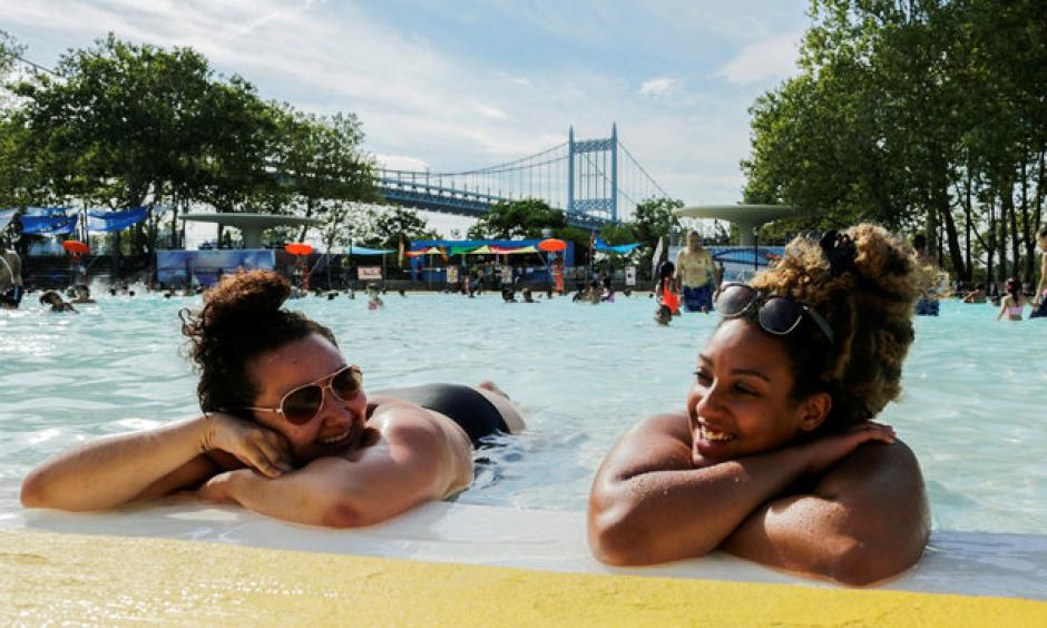 Women enjoy a day in the pool in the Queens borough of New York, during a heat wave on July 24, 2016. Credit: Eduardo Munoz, Reuters