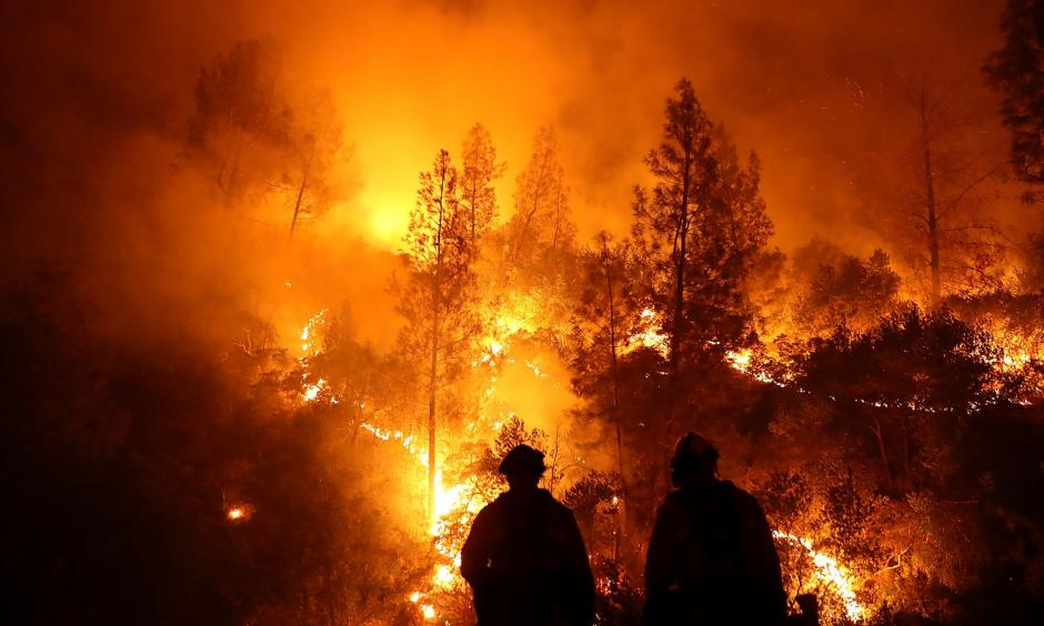 Firefighters battle the Mendocino Complex fire in Northern California. Photo: Justin Sullivan via Getty Images