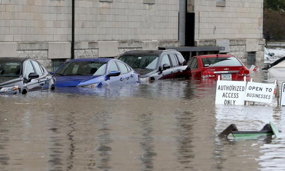 Flooded cars parked next to the Peterson Paper Loft Apartment building on Pershing Avenue at East 2nd Street in Davenport after a flood barrier was breached by Mississippi floodwaters on Tuesday. Credit: John Schultz