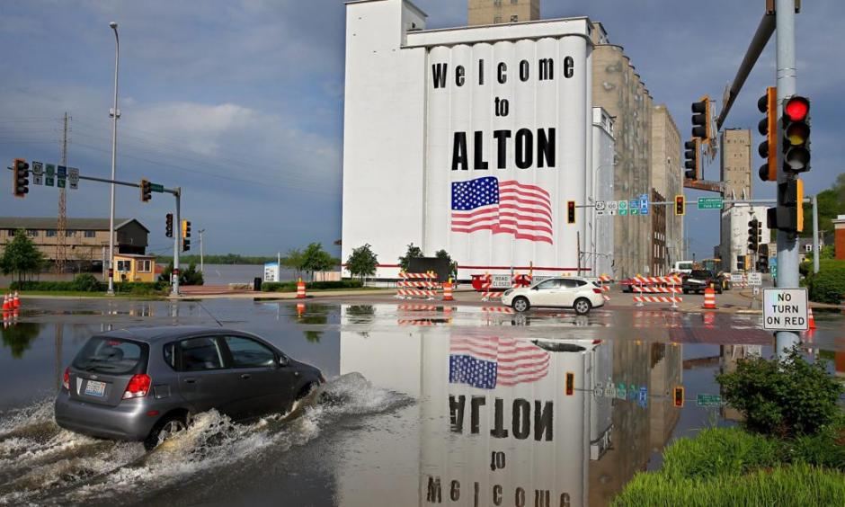 A car drives through Mississippi River flood water in downtown Alton on Monday, May 6 2019. Photo: David Carson, Post Dispatch