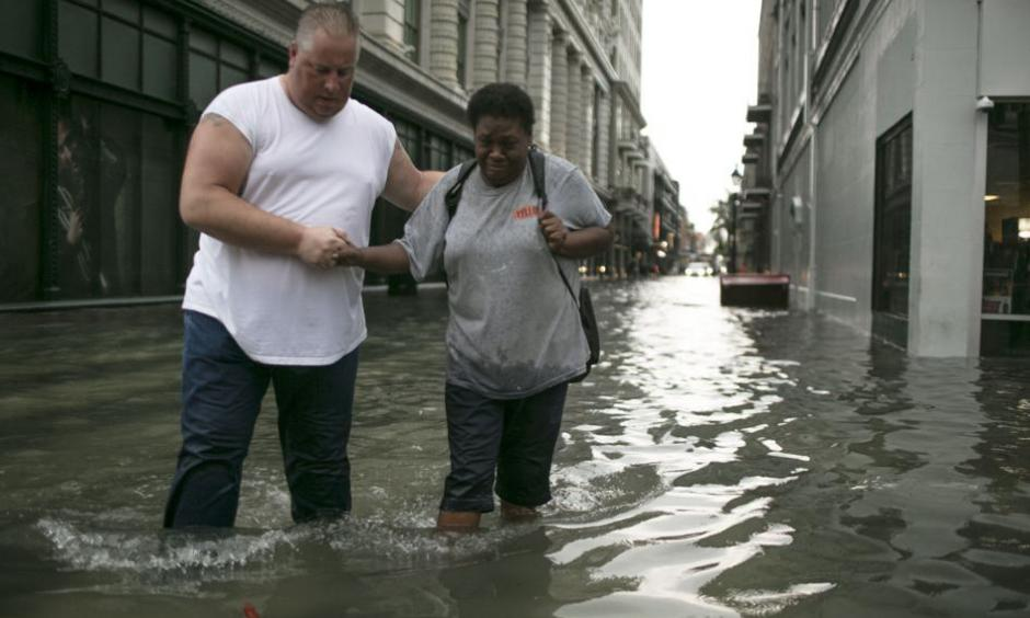 Pedestrians make their way through high water in the CBD after a downpour and flood in New Orleans. Credit: Chris Granger, NOLA