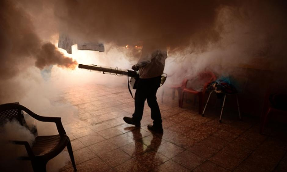 A home in El Salvador being fumigated to prevent the spread of the Zika virus. Photo: Marvin Recinos, AFP/Getty Images