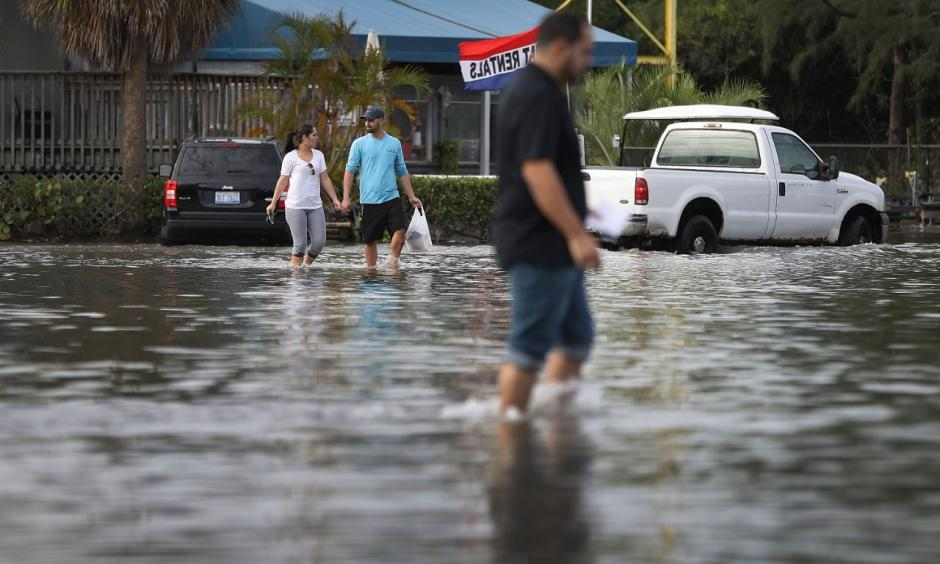 North Miami, Florida was flooded due to the effects of the magnified high tide of this week's unusually close full Moon. That, and the effects of decades of sea level rise due to global warming. Photo: Joe Raedle, Getty Images