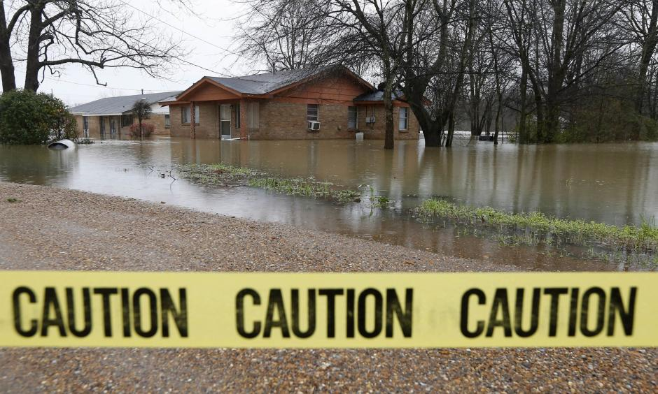 Caution tape closes off this neighborhood in Drew, Miss., Friday, March 11, 2016, as floodwaters have affected areas in the Delta. The flooding has affected the Delta to varying degrees. Photo: Rogelio V. Solis, AP
