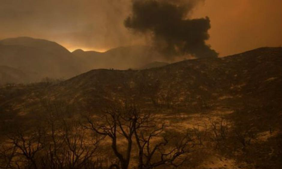 A scorched landscape is left smoldering at the Sand Fire on July 23 2016 near Santa Clarita, California. Photo: David McNew/ AFP-Getty