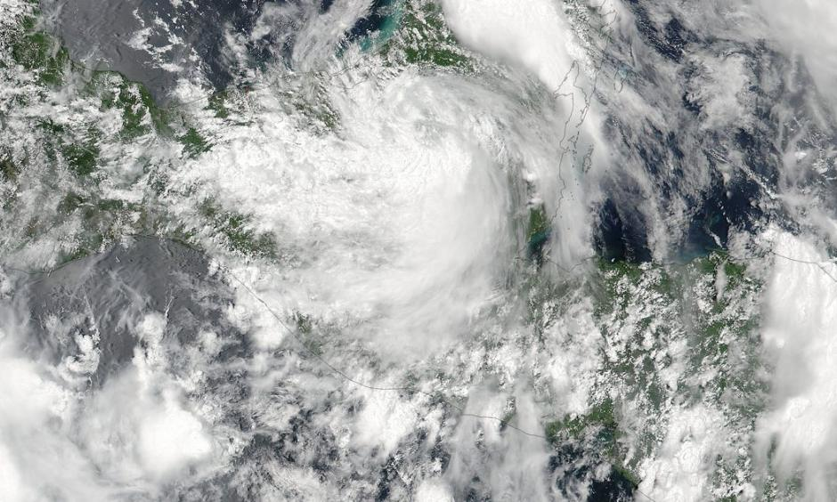 A NASA handout picture shows a true color image acquired from NASA-NOAA Suomi NPP satellite of Tropical Storm Earl over the Yucatan Peninsula, Mexico, on August 4. Image: NASA/NOAA, EPA