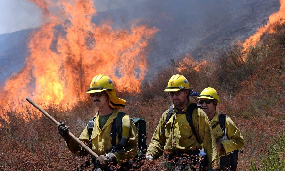 Firefighters battle the Blue Cut Fire along Swarthout Canyon Road in the Cajon Pass, north of San Bernardino, California, on Aug. 16, 2016. Photo: Will Lester, The Sun via AP