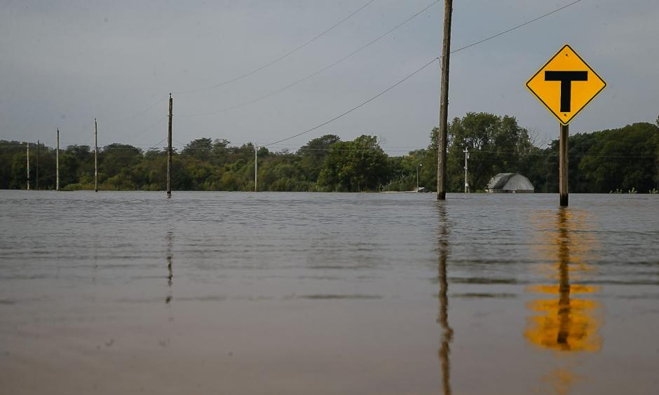 A gravel road sits underwater on Saturday, Sept. 24, 2016, in Cedar Falls. Photo: Brian Powers, The Register