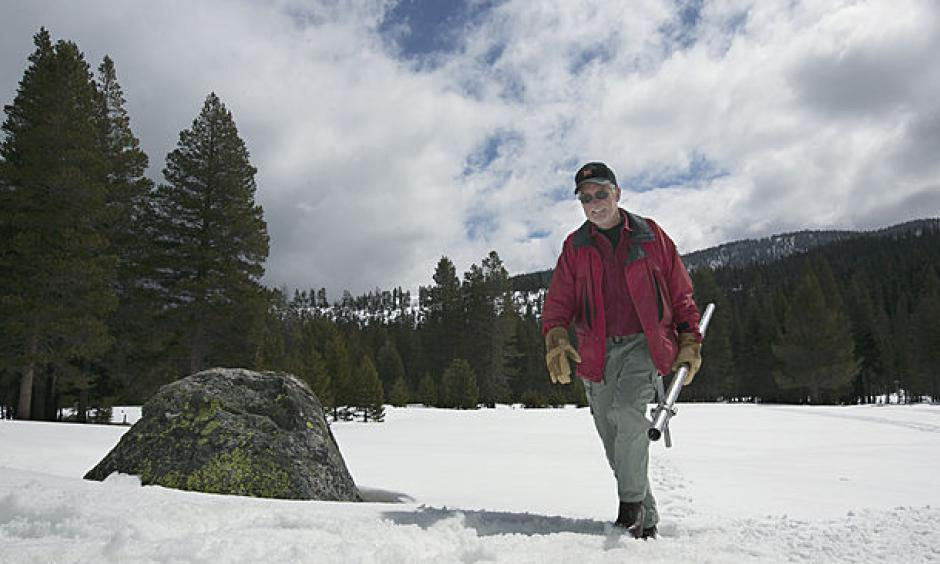 Frank Gehrke, chief of the California Cooperative Snow Surveys Program for the Department of Water Resources, leaves the snow covered meadow after conducting the snow survey at Phillips Station near Echo Summit, Calif., Wednesday, March 30, 2016. Photo: Rich Pedroncelli, AP