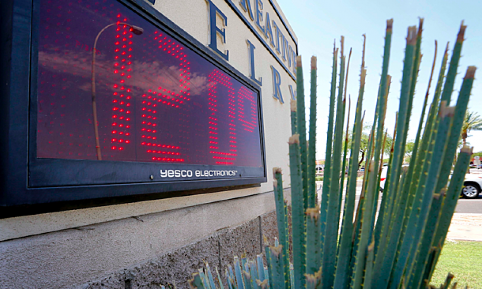 A sign, in direct sunlight, indicates 120 degrees, Monday, June 20, 2016, in Phoenix. On Sunday, the mercury climbed to 118, breaking a record of 115 set nearly 50 years ago. Photo: Matt York, AP