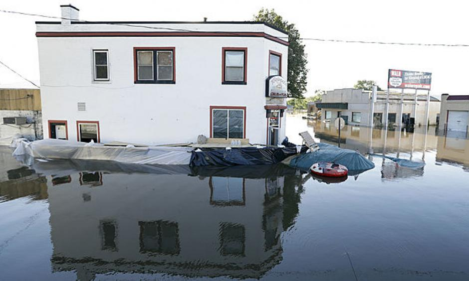 The Tornado's Grub & Pub sits surrounded in flood waters from the Cedar River, Tuesday, Sept. 27, 2016, in Cedar Rapids, Iowa. The city hastily erected 9.8-mile system of Hesco barriers and earthen berms was largely holding back the Cedar River, which was cresting at its second-highest level in history. Photo: Charlie Neibergall, AP