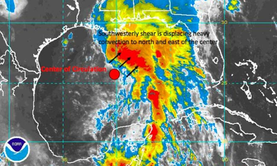 Southwesterly wind shear was displacing the heaviest convection to the north and east of the center of circulation for Potential Tropical Cyclone 3 this morning. Background image: NOAA, Markups: Hal Needham. Image: NOAA