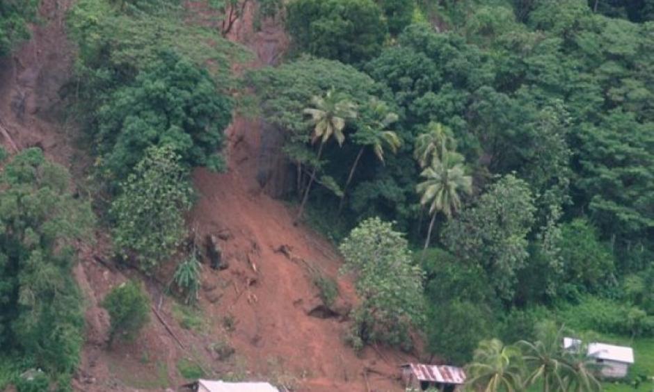 Tukuraki Village seen swamped under dirt after a landslide. Photo: Janet Lotawa