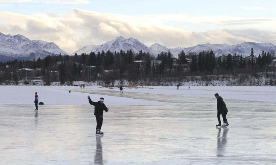 In this January 2, 2018 file photo, ice skaters take advantage of unseasonably warm weather to skate outside at Westchester Lagoon in Anchorage, Alaska. Photo: Mark Thiessen, AP