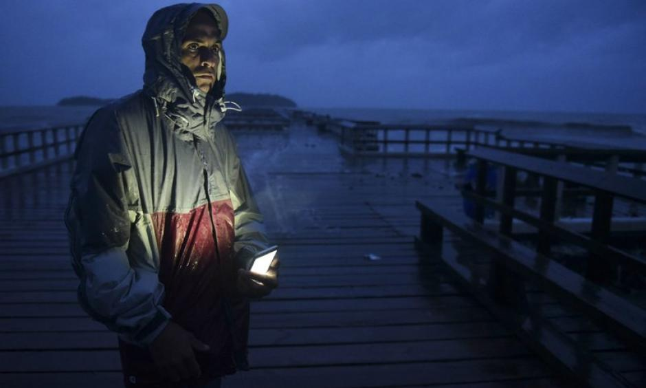 David Cruz Marrero watches the waves at Puncta Santiaga pier hours before the imminent impact of Maria, a Category 5 hurricane that threatens to hit the eastern region of the island with sustained winds of 165 miles per hour, in Humacao, Puerto Rico, Tuesday, September 19, 2017. Photo: Carlos Giusti, AP