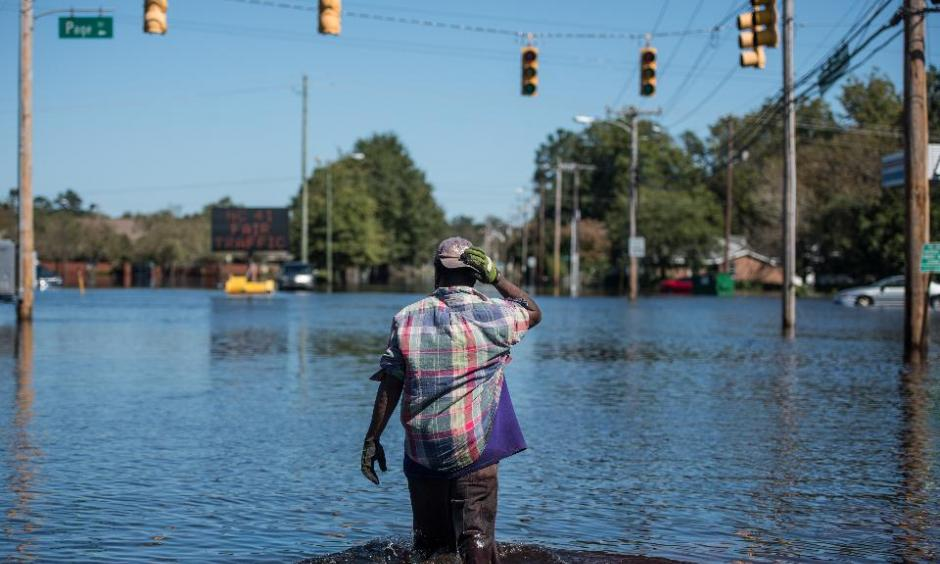 Chris Moore walks down Martin Luther King Blvd. on October 12, 2016 in Lumberton, North Carolina. Hurricane Matthew's heavy rains ended over the weekend, but flooding is still expected for days in North Carolina. Photo: Sean Rayford/Getty Images