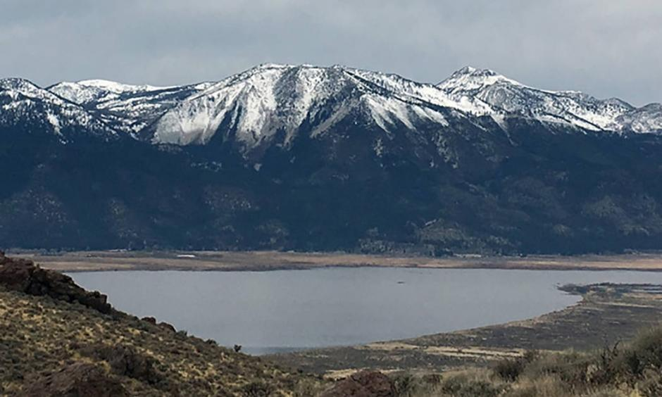 The view from the east side of Washoe Lake on Jan. 7 shows what snow drought looks on Slide Mountain and Mount Rose near Reno. Photo: Benjamin Hatchett, DRI