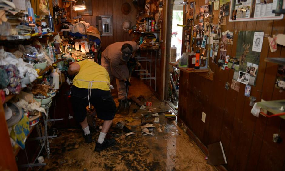 A Coast Guard team help cleanup a house in Baton Rouge in the wake of this summer's extreme floods. Photo: Coast Guard News/flickr