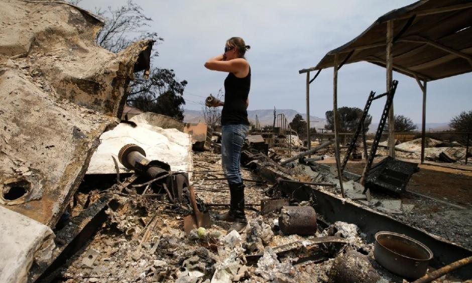 "Amy Nelson, 30, breaks down as she goes through the remains of her home devastated by the Erskine Fire, Saturday, June 25, 2016, in South Lake, Calif. ""I didn't think it was going to be this bad,"" said Nelson. Photo: Jae C. Hong, AP"