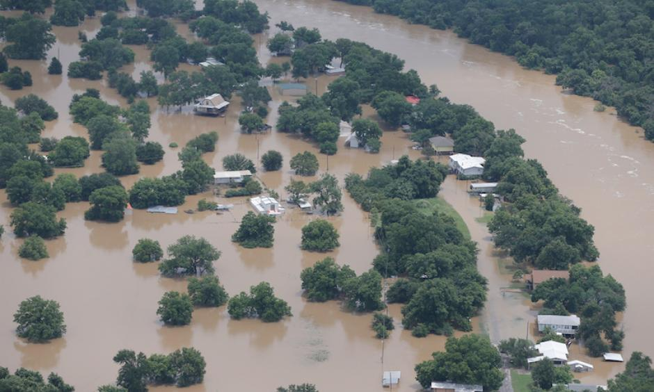 An aerial view of homes in the Horseshoe Bend area on the banks of the Brazos River in north central Texas on Wednesday, June 1, 2016. Residents of some rural southeast Texas counties braced for more flooding along the river that is expected to crest at a record level just two years after it had run dry in places because of drought. Photo: Brandon Wade, Star-Telegram via AP