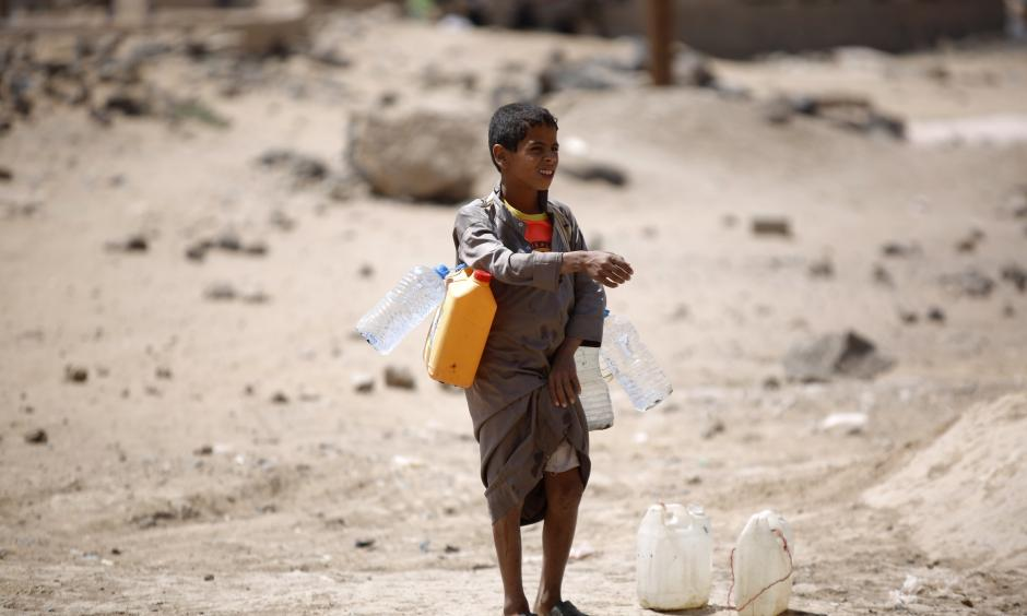 A boy carries buckets filled with water from a public tap amid an acute shortage of water, on the outskirts of Sanaa, Yemen. Water scarcity has been blamed for contributing to instability in the country. Photo: Hani Mohammed, Associated Press